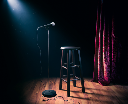 stage ready for next available comedian scheduled on show calendar